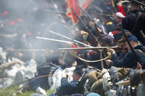 Perciavalle (far right, middle, holding rifle) fires a shot during the re-enactment of Pickett's Charge in the Battle of Gettysburg.